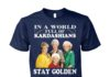 In a world full of kardashians stay golden unisex cotton tee