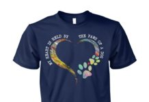 My heart is held by the paws of a dog unisex cotton tee