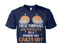 These pumpkins are protected by a smokin hot smartass tattoed asshole unisex cotton tee