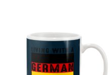 Living with a German builds character mug